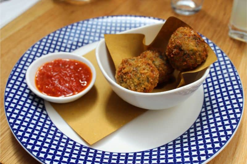 Scamorza Arancini Sicilian rice balls filled with spinach and smoked mozzarella at Carluccio's York.